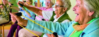 Elderly ladies exercising in a gym - copyright by Bela Hoche
