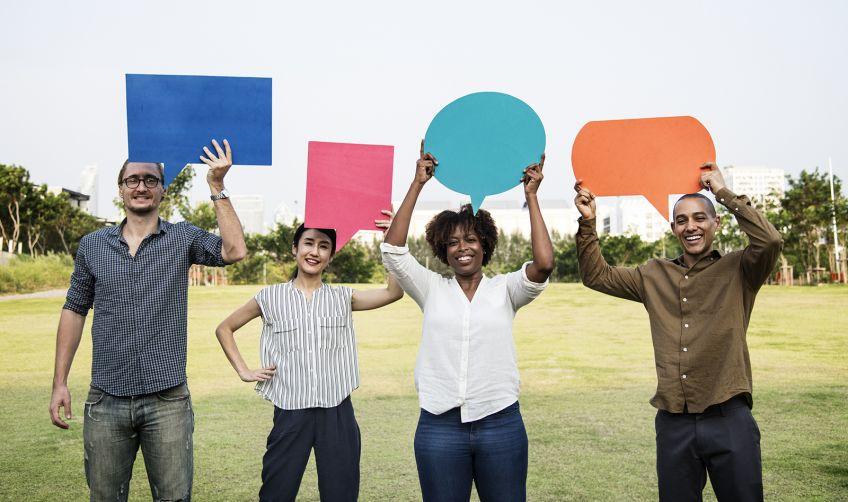 Diverse friends holding speech bubbles - Rawpixel Ltd. - Diverse friends holding speech bubbles