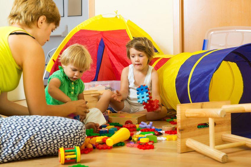 Mother and children playing  - Iakov Filimonov - Young mother and children playing with  toys in home